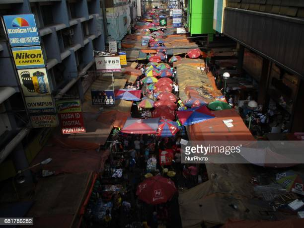 People walk through a marketplace at the bustling Quiapo district in Manila Philippines on Wednesday May 10 2017 On its inaugural flagship report on...