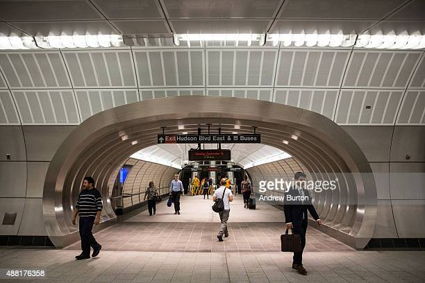 People walk through a new subway station on September 14 2015 in New York City Known as '34th Street Hudson Yards' it is accessed by the 7 train and...