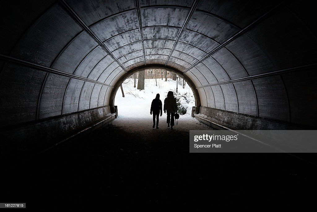 People walk through a pedestrian tunnel in a snowy Prospect Park in Brooklyn the morning after a massive snow storm on February 9, 2013 in New York City. New Yorkers woke up to over 10 inches of snow Saturday morning while parts of New England received over thirty inches following a storm that brought high winds and blizzard like conditions to the region.