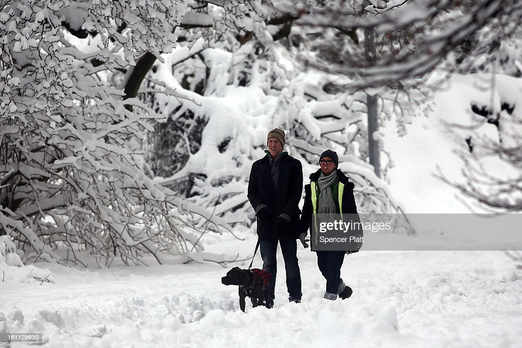 People walk through a snowy in Prospect Park in Brooklyn the morning after a massive snow storm on February 9, 2013 in New York City. New Yorkers woke up to over 10 inches of snow Saturday morning while parts of New England received over thirty inches following a storm that brought high winds and blizzard like conditions to the region.