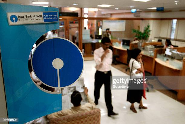People walk through a State Bank of India branch in Mumbai India on Friday July 27 2007 State Bank of India the nation's largest lender may not raise...