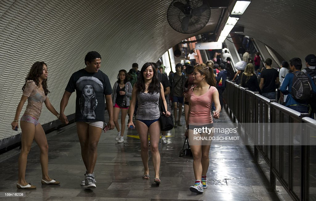 People walk through a subway station during the worldwide 'No Pants Subway Ride' event in Mexico City on January 13, 2013. The 'No Pants Subway Ride', though in its 12th year, still surprises fellow passengers on public transit, and is spreading to other cities across the globe.