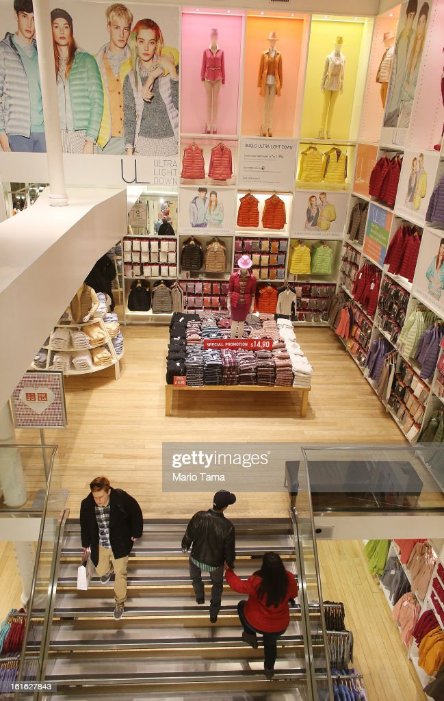 People walk through a Uniqlo store in Manhattan on February 13, 2013 in New York City. The Commerce Department reported that retail sales were only up slightly in January following tax increases and high gas prices.