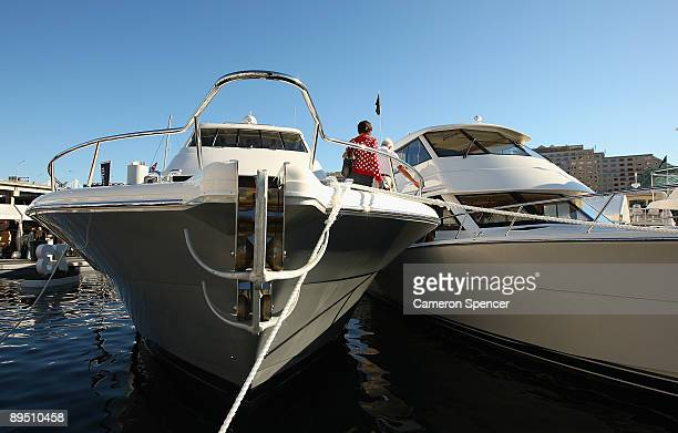 People walk through boats on display at the Sydney International Boat Show at Darling Harbour on July 30 2009 in Sydney Australia A wharf with 190...
