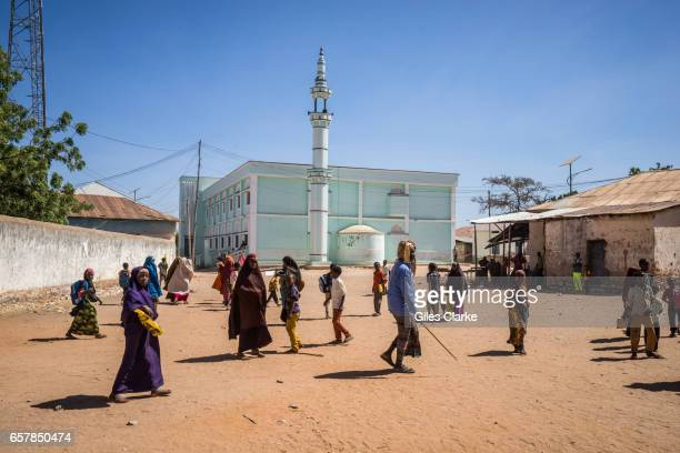 People walk through Dinsor town square in South Eastern Somalia Somalia is in the grip of an intense drought induced by consecutive seasons of poor...