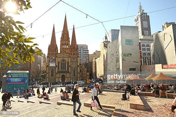 People walk through Federation Square on August 18 2016 in Melbourne Australia Melbourne has been named as the world's most liveable city for a sixth...