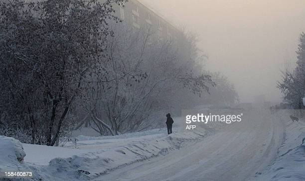 People walk through frost haze in the Siberian city of Novosibirsk about 2800 km east of Moscow on December 16 2012 The temperatures in Novosibirsk...