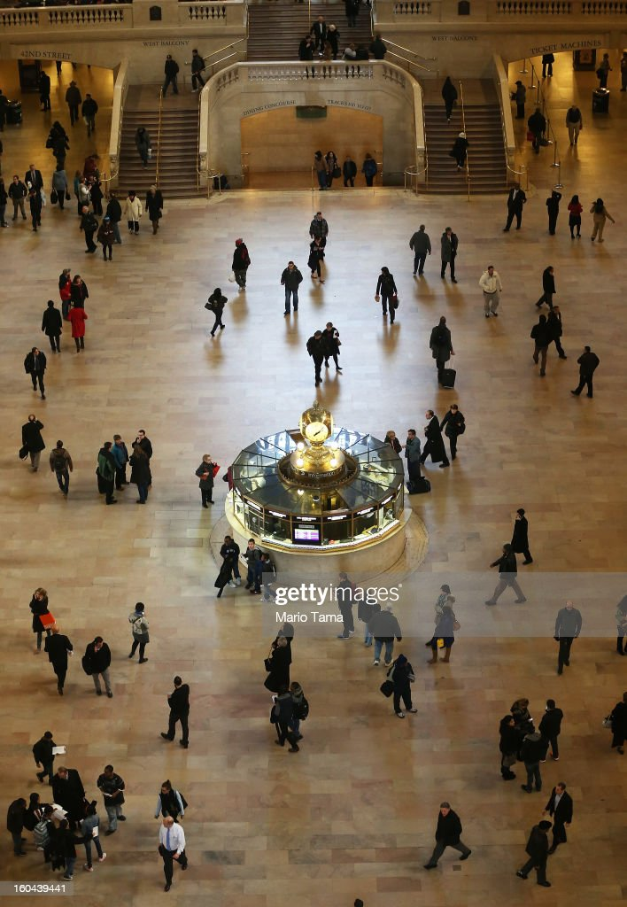 People walk through Grand Central Terminal on the day before the famed Manhattan transit hub turns 100 years old on January 31, 2013 in New York City. The terminal opened in 1913 and is the world's largest terminal covering 49 acres with 33 miles of track. Each day 700,000 people pass through the terminal where Metro-North Railroad operates 700 trains per day.