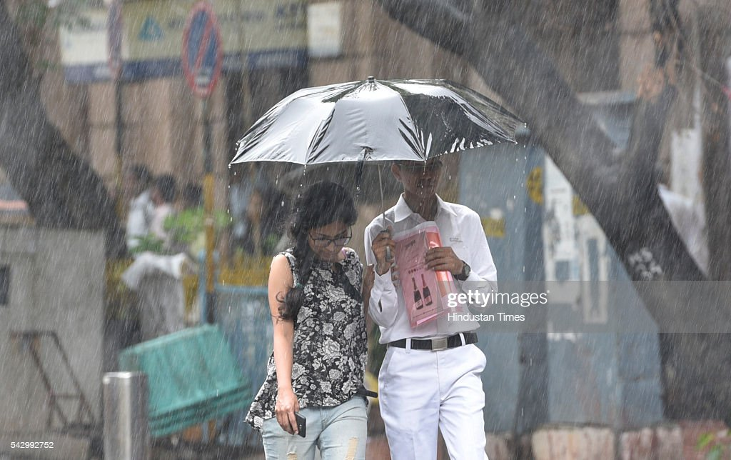 People walks through heavy shower, on June 24, 2016 in Mumbai, India. Rains continued to lash Mumbai for the third consecutive day today, slightly disrupting suburban train services, even as the Met department predicted heavy showers. India Meteorological Departments Regional Meteorological Centre in Mumbai predicted intermittent rain with heavy to very heavy rainfall at a few place in the city and its suburbs for the next 24 to 48 hours.