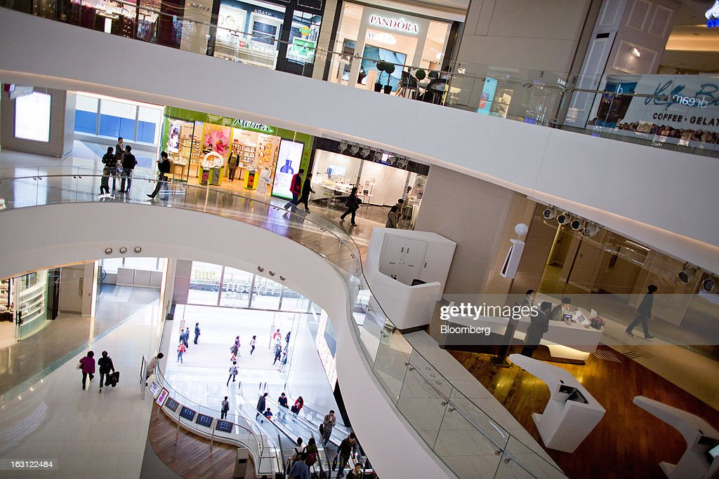 People walk through Hysan Development Co.'s Hysan Place mall in the Causeway Bay district of Hong Kong, China, on Monday, March 4, 2013. Hysan is scheduled to release earnings on March 6. Photographer: Lam Yik Fei/Bloomberg via Getty Images