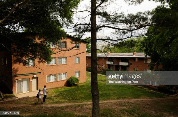 People walk through Lynbrook Apartments on Tuesday May 01 2012 in Alexandria VA Many residents in the Beauregard Corridor are against proposed...
