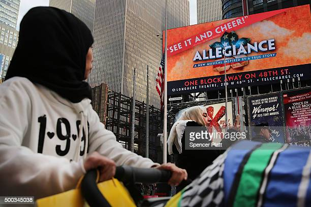 People walk through New York's Times Square on December 7 2015 in New York City Following a series of mass shootings in the US and the terrorist...