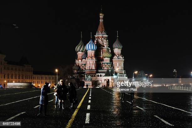 People walk through Red Square in Moscow on March 7 2017 in Moscow Russia Relations between the United States and Russia are at their lowest point in...