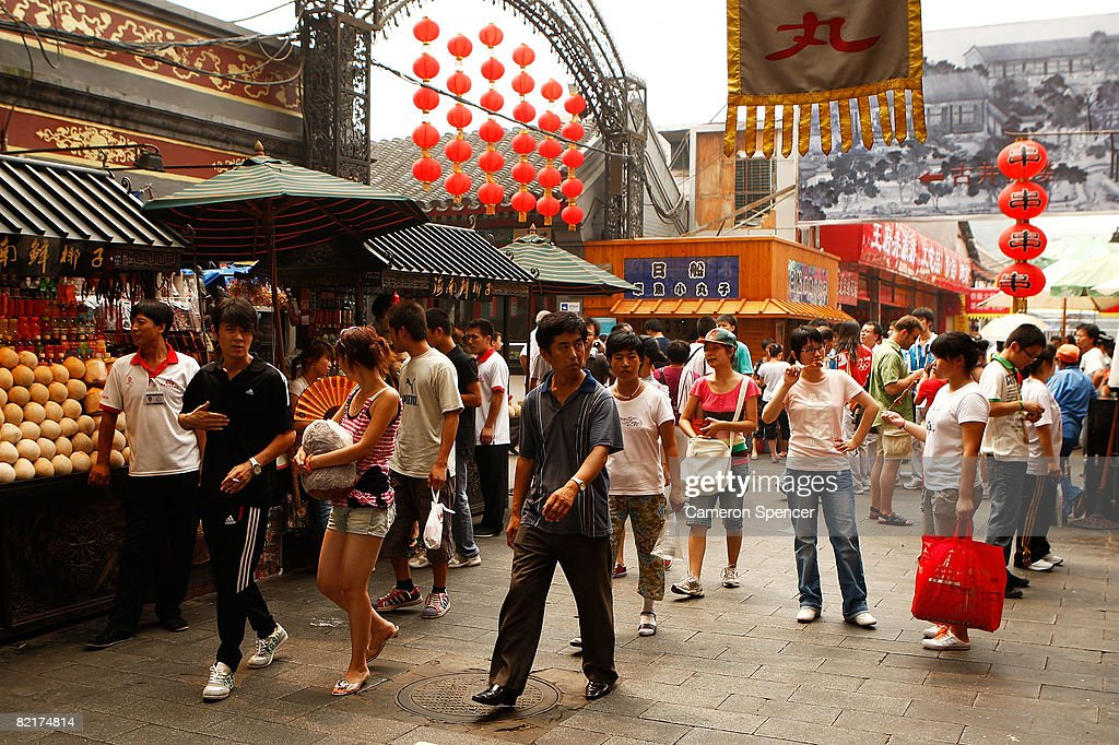 People walk through stalls at the Wangfujing markets ahead of the Beijing 2008 Olympic Games on August 4 2008 in Beijing China