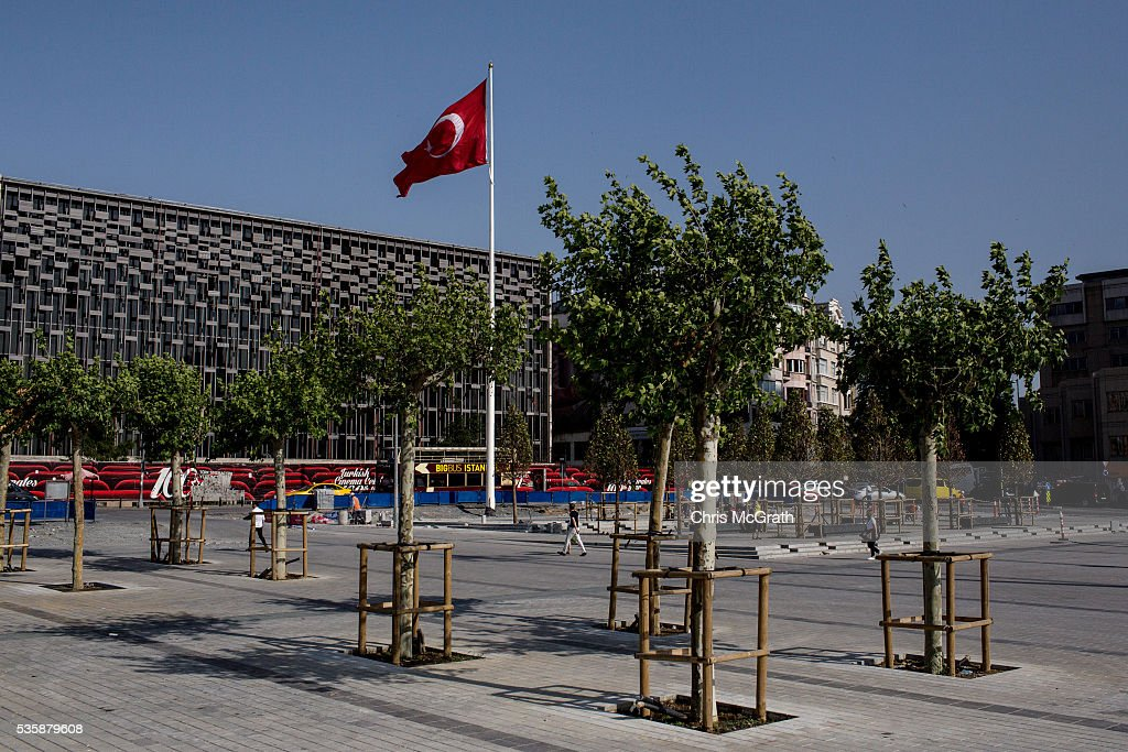 People walk through Taksim square on the eve of the 3rd anniversary of the Gezi Park protests on May 30, 2016 in Istanbul, Turkey. The protests began on May 28, 2013 to contest the planned urban development of Gezi Park however larger protests started after police evicted protesters from the park sparking weeks of civil unrest.