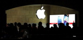 People walk through the Apple retail store in Grand Central Terminal on December 10 2012 in New York City Apple Inc stock was down $456 per share or...