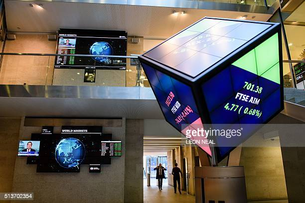People walk through the central atrium at the Londson Stock Exchange in central London on March 4 2016 London Stock Exchange Group posted surging...
