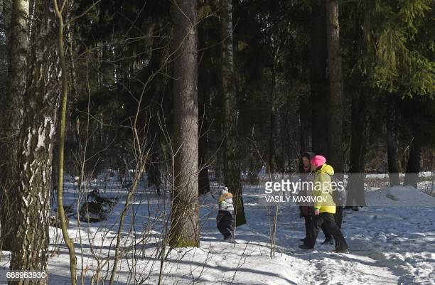 People walk through the Chelyuskinsky Wood outside Moscow on February 16 2017 Just six kilometres from Vostochnaya Perlovka residents of another...
