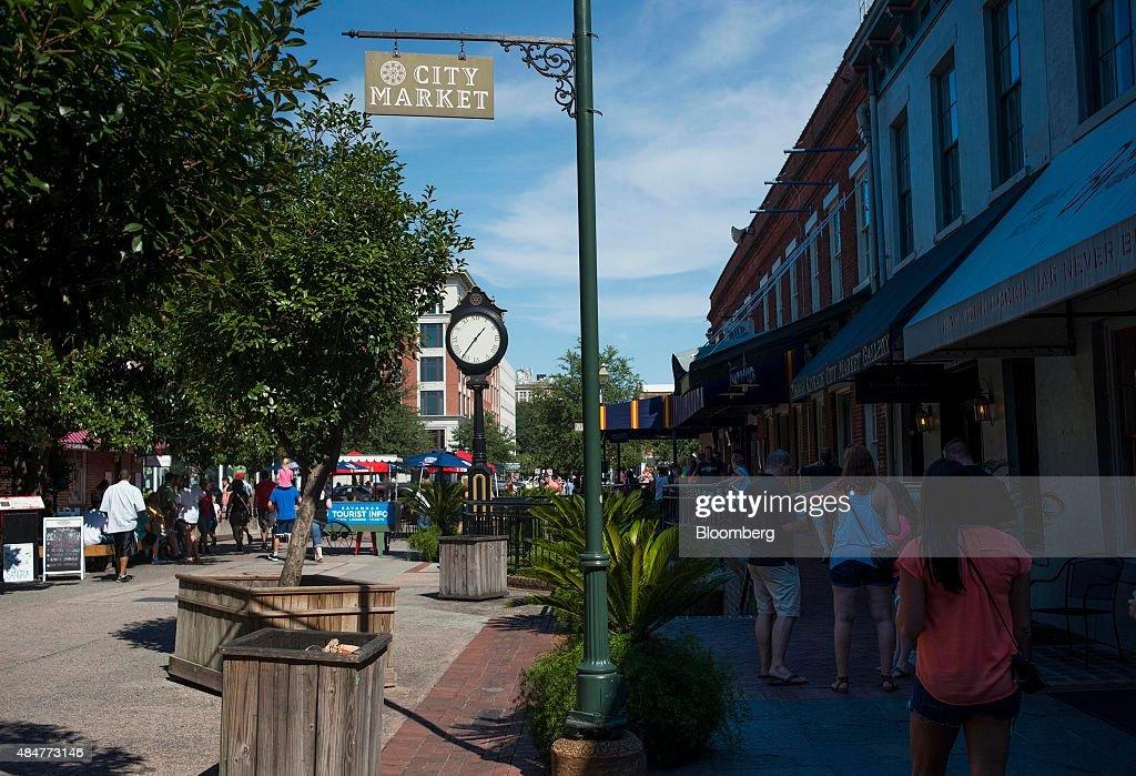 People walk through the City Market in Savannah Georgia US on Saturday Aug 15 2015 Savannah the oldest city and thirdlargest metropolitan area in...