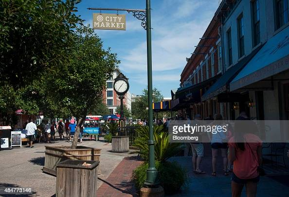 People walk through the City Market in Savannah Georgia US on Saturday Aug 15 2015 Savannah the oldest city and thirdlargest metropolitan area in...