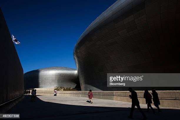 People walk through the Dongdaemun Design Plaza in Seoul South Korea on Saturday Oct 3 2015 South Korea may be turning a corner After months of gloom...