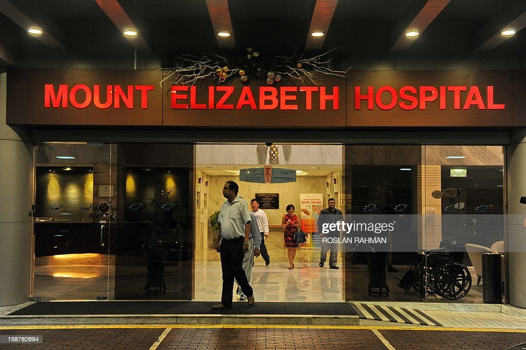 People walk through the entrance of the Mount Elizabeth hospital in Singapore, on December 29, 2012. The medical condition of an Indian gang-rape victim has 'taken a turn for the worse' with 'signs of severe organ failure', the Singapore hospital treating her said in a statement issued late on December 28, 2012.