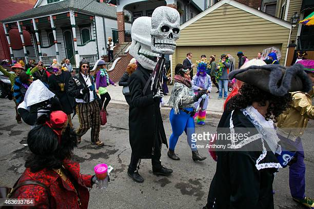 People walk through the Faubourg Marigny neighborhood during Mardi Gras February 17 2015 in New Orleans Louisiana Mardi Gras or Fat Tuesday is a...