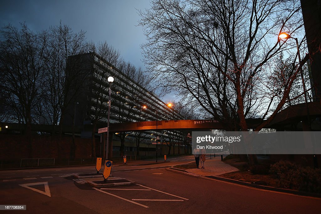 People walk through the Heygate Estate in the Walworth area at twilight on April 26, 2013 in London, England. The Heygate estate in central London was built in 1974 as social housing and housed around 3000 people, but fell into a state of disrepair, gaining a reputation for crime and poverty. The estate is due to be demolished as part of the £1.5billion GBP 'Elephant & Castle regeneration scheme', and replaced with 2,500 'affordable' new homes. The area has become popular with street artists, storytellers, and guerilla gardeners and attracts an array of urban wildlife including bats, birds and mammals.