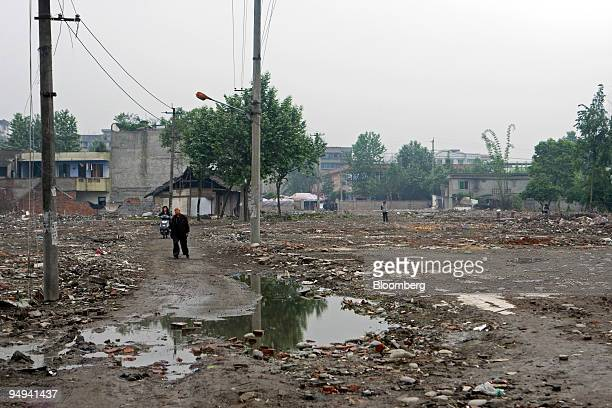 People walk through the Juyuan Middle School site in Juyuan Sichuan province China on Friday May 8 2009 China said it has found no evidence corrupt...