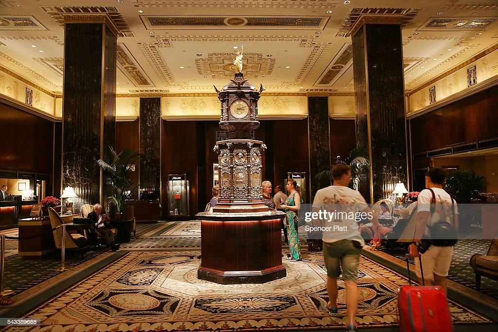 People walk through the lobby of New York's landmark Waldorf Astoria Hotel on June 27, 2016 in New York City. China's Anbang Insurance Group, which recently purchased the Waldorf from Hilton Worldwide Holdings in 2014 for $1.95 billion, has announced plans to convert as much as three-quarters of the rooms into apartments. The insurer will close the Waldorf for up to three years starting next spring for the renovation.