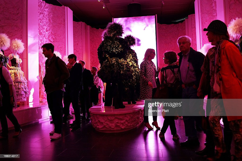 People walk through the Metropolitan Museum of Art's Spring 2013 Costume Institute exhibition entitled 'PUNK: Chaos to Couture' on May 8, 2013 in New York City. Featuring one hundred menswear and womenswear designs, the show examines punk's impact on high fashion from the movement's birth in the early 1970's to its continuing influence today. The show will be held until the 14 August.