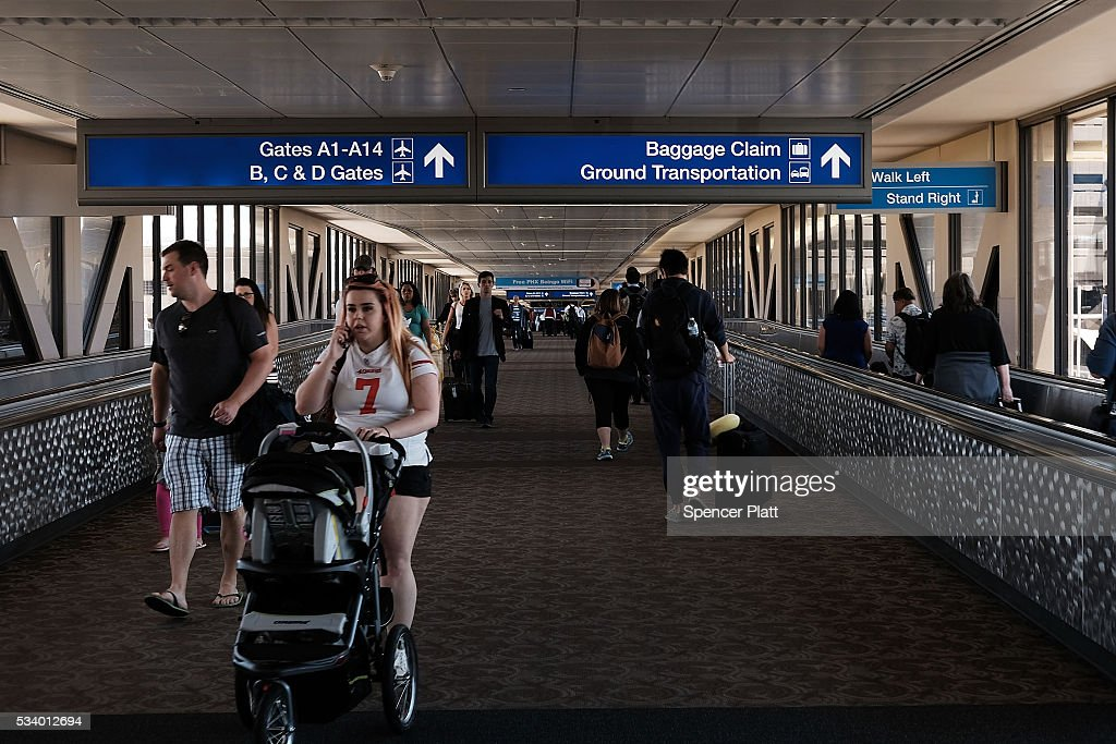 People walk through the Phoenix airport on May 24, 2016 in Phoenix, Arizona. The Transportation Security Administration (TSA) has come under renewed criticism from government officials and the general public following an escalation of wait times at security screenings at domestic airports as the summer travel season begins. Kelly Hoggan, the Transportation Security Administration's head of security operations, has been put on paid administrative leave pending reassignment.
