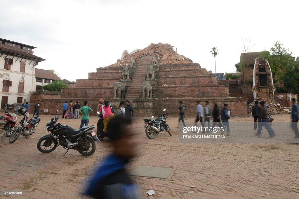 People walk through the ruins of Bhaktapur's Durbar Square a UNESCO World Heritage Site on the outskirts of Kathmandu on April 27 two days after a 78...