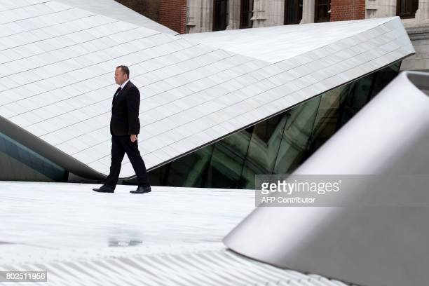 People walk through the Sackler Courtyard a new addition to the Victoria and Albert museum as it is unveiled to the public in London on June 28 2017...