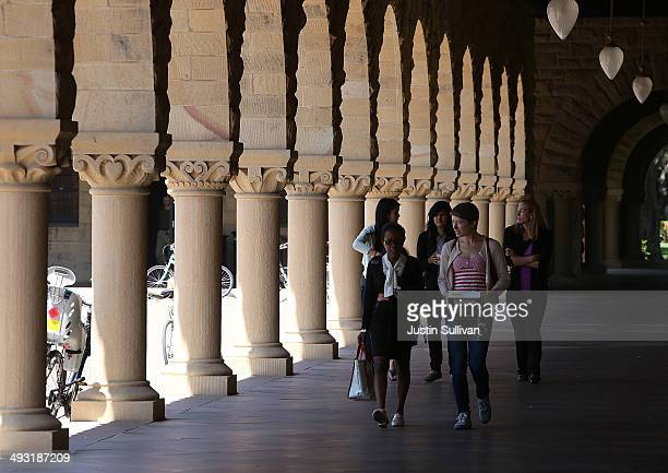 People walk through the Stanford University campus on May 22 2014 in Stanford California According to the Academic Ranking of World Universities by...
