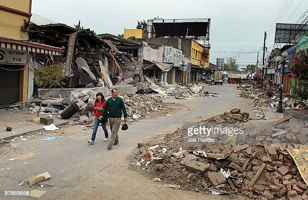 People walk through the streets as the city continues to deal with the aftermath of the recent earthquake on March 12 2010 in Talca Chile The newly...
