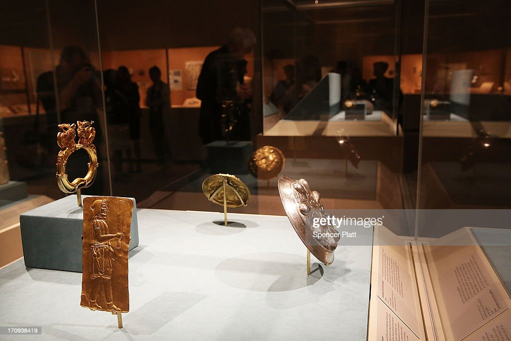 People walk through the traveling exhibition The Cyrus Cylinder and Ancient Persia: Charting a New Empire at The Metropolitan Museum of Art on June 20, 2013 in New York City. One of the most famous surviving icons from the ancient world, the Cyrus Cylinder is the centerpiece of the traveling exhibition The Cyrus Cylinder and Ancient Persia: Charting a New Empire.