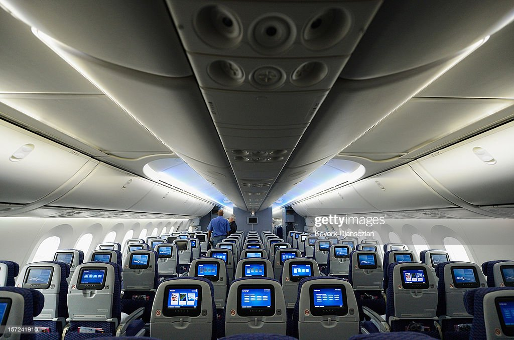 People walk through the United Airlines Economy Class with personal entertainment systems, with 13 languages available, on the new Boeing 787 Dreamliner at Los Angeles International Airport on November 30, 2012 in Los Angeles, California. In January the new jet is scheduled to begin flying daily non-stop between Los Angeles International airport and Japan's Narita International Airport and later to Shanghai staring in March. The new Boeing 787 Dreamliner will accommodate 219 travelers with 36 seats in United Business First, 70 seats in Economy Plus and 113 in Economy Class. The carbon-fiber composite material that makes up more than 50 percent of the 787 makes the plane more fuel-efficient.