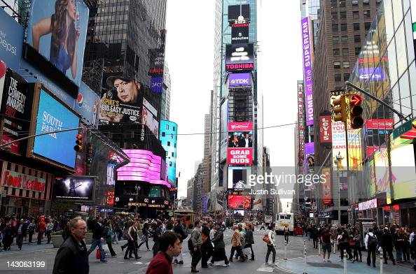 People walk through Times Square on April 18 2012 in New York City American Bandstand host and TV producer Dick Clark died of a heart attack...