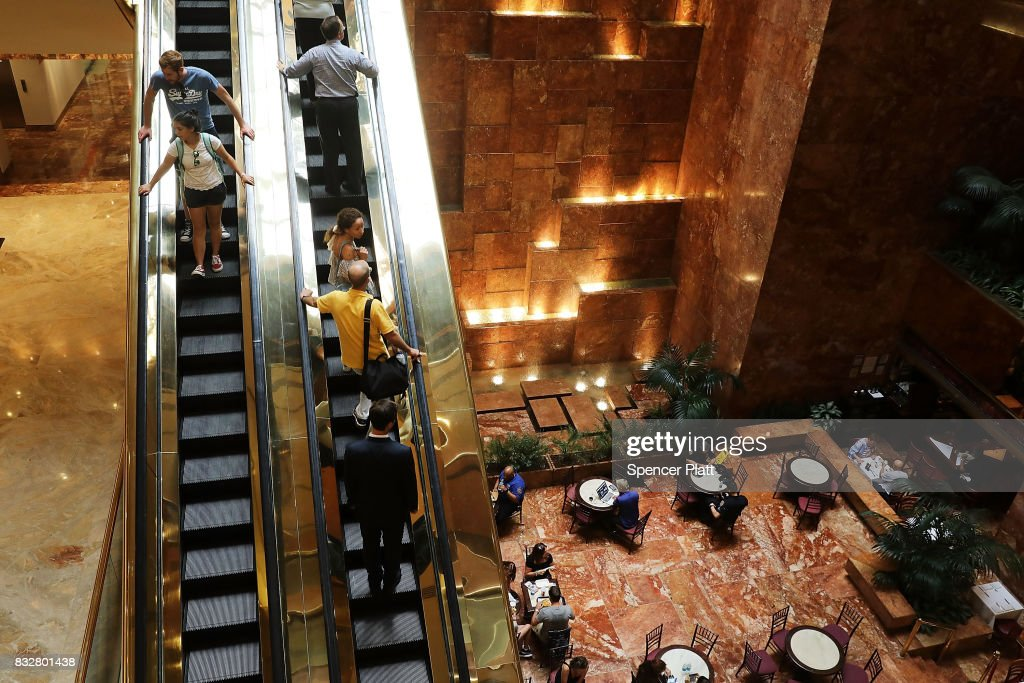 People walk through Trump Tower after it re-opened to the public following the departure of US President Donald Trump on August 16, 2017 in New York City. President Trump arrived at his residency at the tower on Monday evening, his first trip back to Trump Tower since the inauguration.