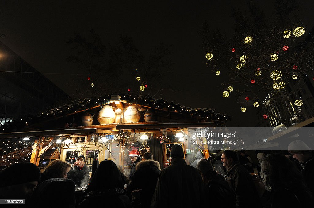 People walk to look for Christmas gifts in Vorosmarty square of Budapest on December 23, 2012 at a Christmas market in the heart of the city.