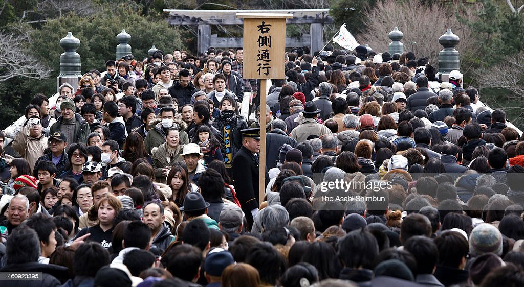 People walk to pay their first visit of the year to Ise Shrine on January 2, 2014 in Ise, Mie, Japan. Ise Shrine welcomed 14.2 Million visitors last year, as they celebrated vicennial 'Shikinen Sengu' in 2013.