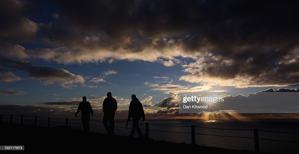 People walk to Signal Hill at sunset on June 15, 2010 in Cape Town, South Africa.