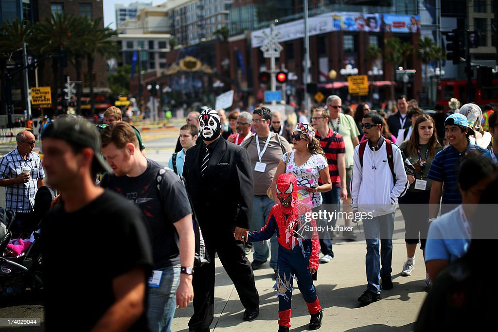 People walk toward the Convention Center during Comic Con on July 19, 2013 in San Diego, California. Comic Con International Convention is the world's largest comic and entertainment event and hosts celebrity movie panels, a trade floor with comic book, science fiction and action film-related booths, as well as artist workshops and movie premieres.