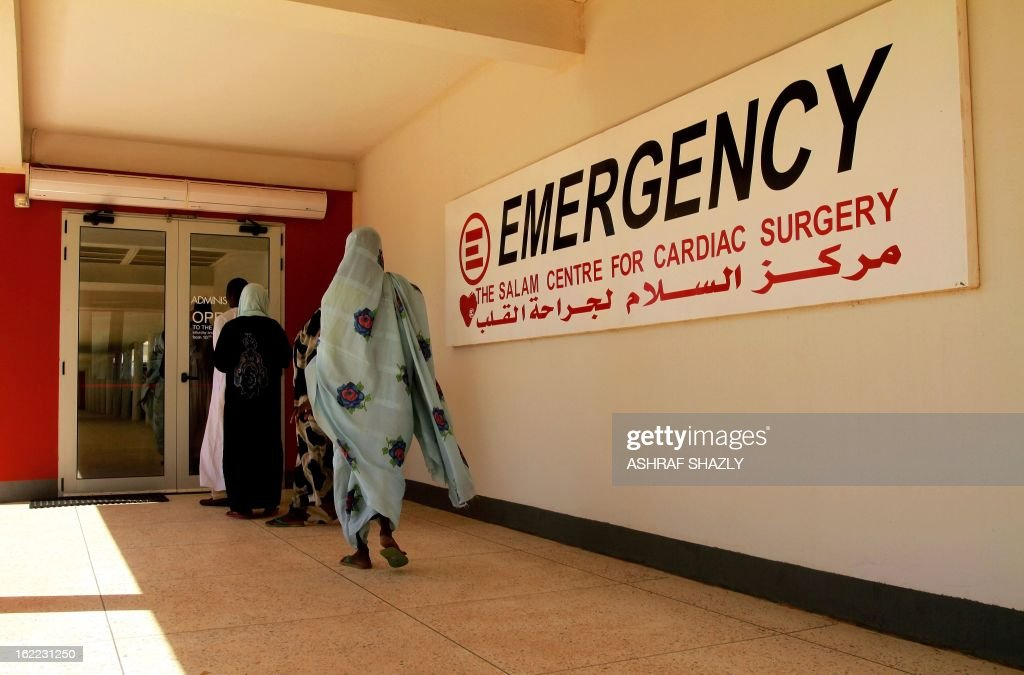 People walk towards the entrance door of the Salam Centre for Cardiac Surgery, which bills itself as Africa's only high-standard specialist facility offering free open-heart operations, on the outskirts of Khartoum, Sudan, on February 20, 2013. The hospital is featured in Kief Davidson and Cori Shepherd Stern's 'Open Heart', which is nominated in the 2013 Oscars' Documentary Short category. It tells the story of eight Rwandan children and teens, one only three years old, who leave home to get life-saving heart operations at Salam Centre, which is run by the Italian non-governmental organisation Emergency.