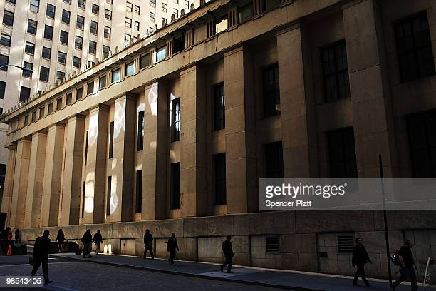 People walk towards Wall Street in the financial district April 19 2010 in New York City Increased scrutiny of numerous Wall Street financial...