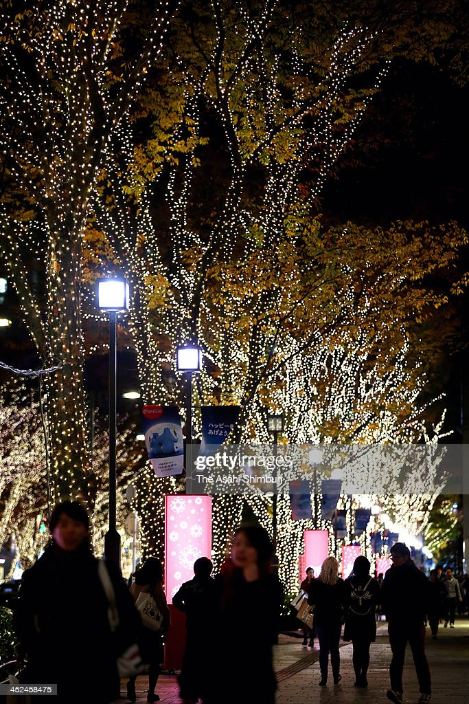 People walk under illuminated Omotesando street on November 28, 2013 in Tokyo, Japan. The illumination, using 500,000 LED lights, takes place until January 5.