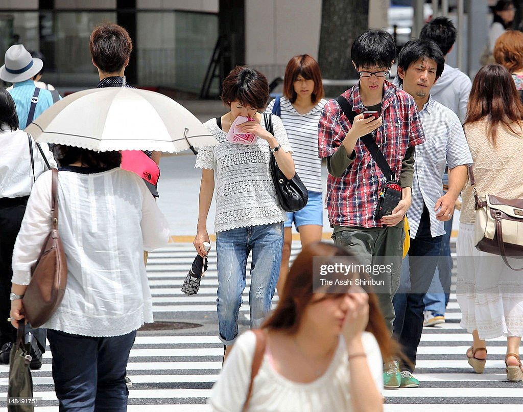 People walk under the hot weather on July 17, 2012 in Nagoya, Aichi, Japan. Japan Meteorological Agency announced that the rainy season seems finish in most of the area in Japan.