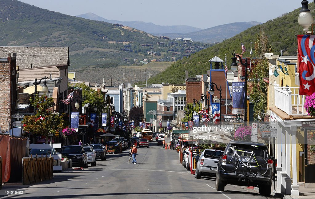 People walk up and down historic Main Street on September 2 2014 in Park City Utah The Park City Mountain Resort is locked in a real estate legal...