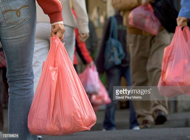 People walk with groceries in plastic bags in Chinatown on March 28 2007 in San Francisco California The Board of Supervisors in San Francisco...